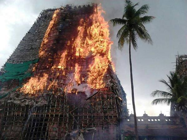 Scaffolding at a temple tower in flames – thanks to fireworks of AIADMK party cadre. (Image : Temple Worshippers Society)
